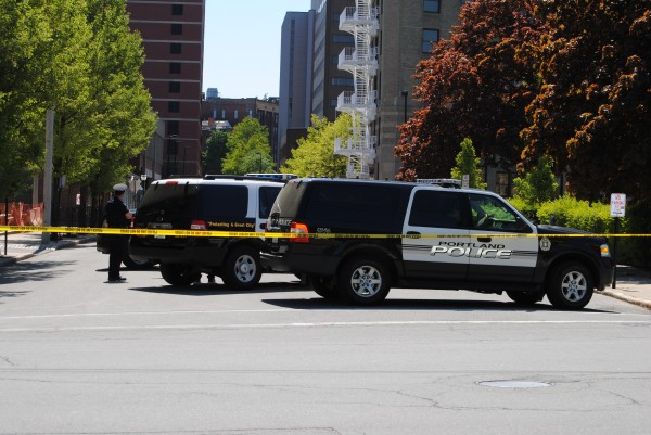 Portland police evacuate Federal Street and block-off streets that reach Congress, Middle and Temple streets while they investigate a suspicious package inside a mailbox on Federal Street in downtown Portland on Saturday, May 19, 2012.