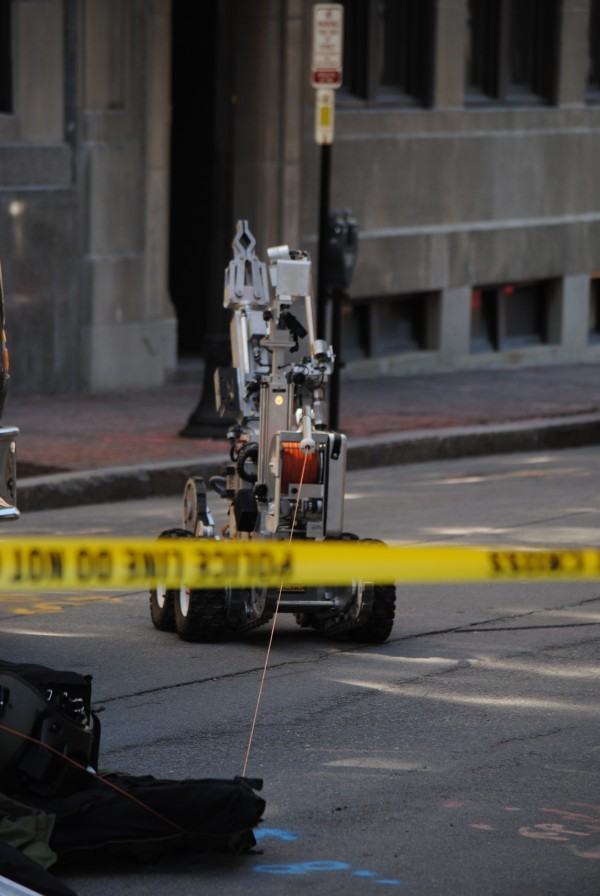 A 5-foot-tall robot controlled by police was being used to investigate a suspicious package inside a mailbox on Federal Street in downtown Portland on Saturday, May 19, 2012.
