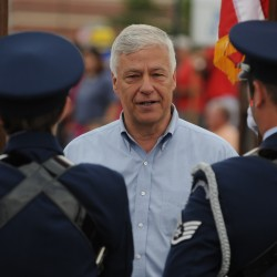 Mike Michaud talks with members of a military marching unit before the Bangor-Brewer Fourth of July parade on Wednesday, July 4, 2012.