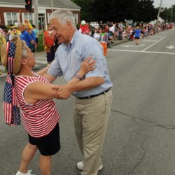Mike Michaud gets a hug from a supporter before the Bangor-Brewer Fourth of July parade on Wednesday, July 4, 2012.