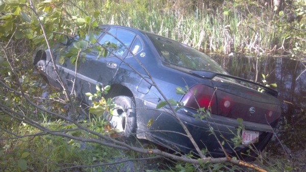 A man suffered minor head injuries when the car he was a passenger in went off Stud Mill Road and into a bog about 4 p.m. Thursday.