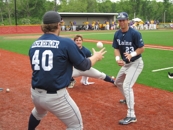 University of Maine baseball teammates (from left) Ian Leisenheimer, Justin Leisenheimer and Colin Gay try to keep the ball alive during a game of &quot2 Ball&quot prior to Thursday's game in the America East Baseball Championship at Joe Nathan Field in Stony Brook, N.Y.