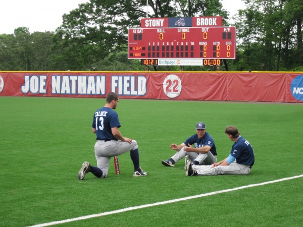 University of Maine baseball coach Steve Trimper (center) talks strategy with players Alex Calbick (left) and Mike Fransoso prior to Thursday's game against Albany at the America East tournament at Joe Nathan Field in Stony Brook, N.Y.