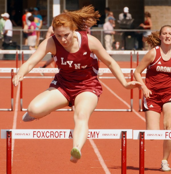 Erica McPhail of Mattanawcook Academy competes in the 100-meter hurdles Saturday at the PVC small school track and field championships at Foxcroft Academy.