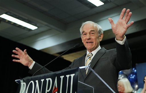 In this Feb. 11, 2012 file photo, Republican presidential candidate Rep. Ron Paul, R-Texas, speaks to his supporters following his loss in the Maine caucus to Mitt Romney, in Portland, Maine.