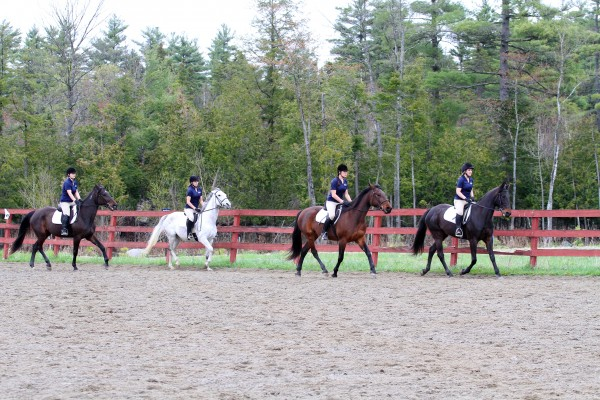Arianna Goulatis on Skittish (left), Amy Bologna on Pembroke Whiteout, Rachel Keating on Dorunbluefortunate and Amanda Flynn on Lacy Asset perform during a drill team performance.