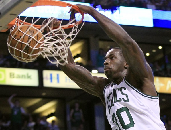 Boston Celtics forward Brandon Bass dunks against the Philadelphia 76ers during the second quarter of Game 7 in an NBA Eastern Conference semifinal playoff series, Saturday, May 26, 2012, in Boston.