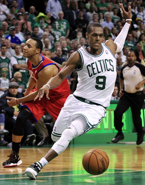 Boston Celtics guard Rajon Rondo (9) eludes contact and dribbles away from Philadelphia 76ers guard Evan Turner, left, in the last seconds of Game 1 in the NBA Eastern Conference semifinal playoff series, Saturday, May 12, 2012, in Boston. The Celtics won 92-91. (AP Photo/Elise Amendola)