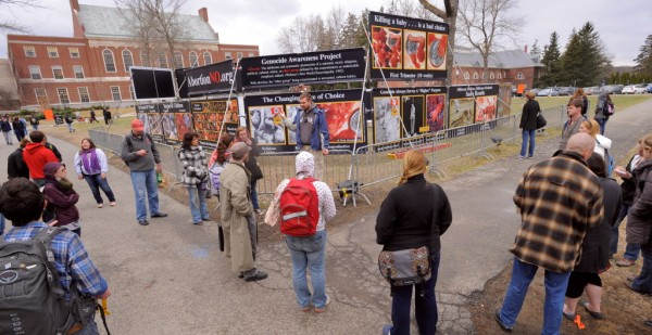 People view a display of images at the University of Maine Monday, April 9, 2012. A group called the Center for Bio-Ethical Reform, protesting abortion, displayed images it calls the Genocide Awareness Project.