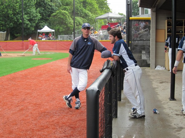 University of Maine volunteer assistant coach Ryan Forrest (left) chats with Black Bears sophomore Eric White of Brewer before the start of Wednesday's game against Stony Brook in the first round of the America East Baseball Championship at Stony Brook, N.Y.
