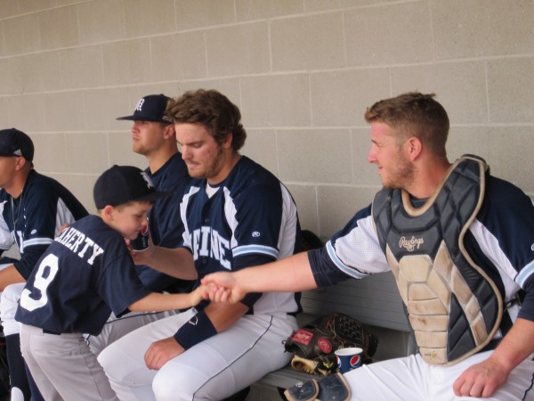 University of Maine catcher Tyler Patzalek (right) plays around in the dugout with Black Bears bat boy Patrick Flaherty as Ian Leisenheimer looks on moments before the start of Wednesday's America East baseball playoff game at Stony Brook, N.Y. Stony Brook won 14-6.