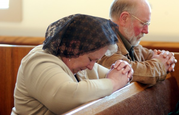 Bar Harbor residents Valery and Mike McCadden pray during a Sunday worship service at the St. Thomas Traditional Anglican Church in Ellsworth.