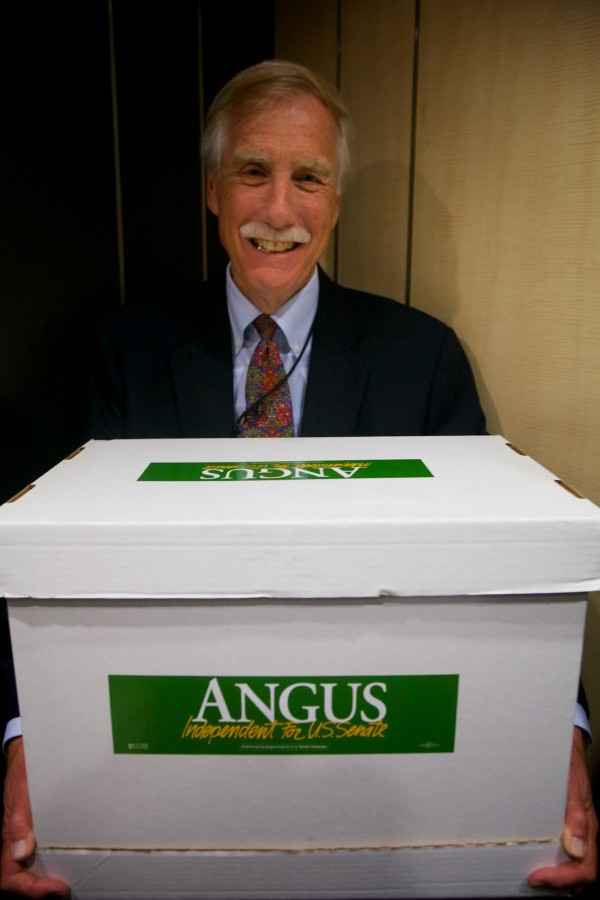 Former governor and U.S. Senate hopeful Angus King waits in a packed elevator with a box of signature-filled petitions in the Cross Building in Augusta Tuesday, May 29, 2012.