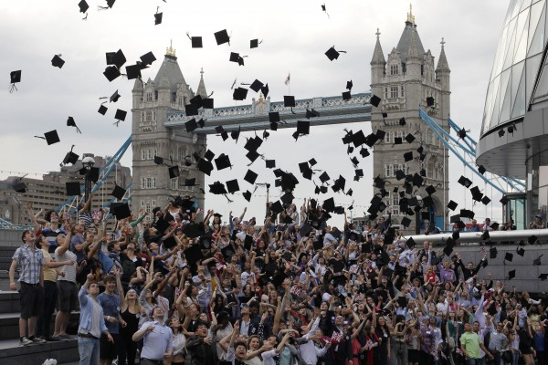Backdropped by Tower Bridge, hundreds of students from more than 100 nationalities toss their mortar boards into the air in a Guinness World Record attempt for the most people throwing mortar boards simultaneously outside City Hall in London as part of World Record London to mark the news that more international students than ever are now studying in London. 295 students took part and set a new Guinness World Record on Wednesday, May 30, 2012.