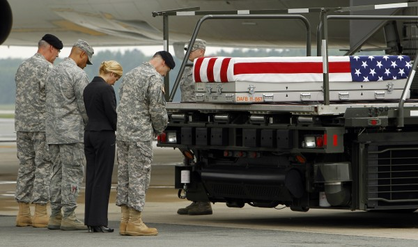 Army chaplain Col. Dennis Goodwin (left) leads a prayer over a transfer case containing the remains of Chief Warrant Officer 5 John C. Pratt during a dignified transfer ceremony at Dover Air Force Base, Del., on Wednesday, May 30, 2012.  According to the Department of Defense, Pratt, of Springfield, Va., died while supporting Operation Enduring Freedom.
