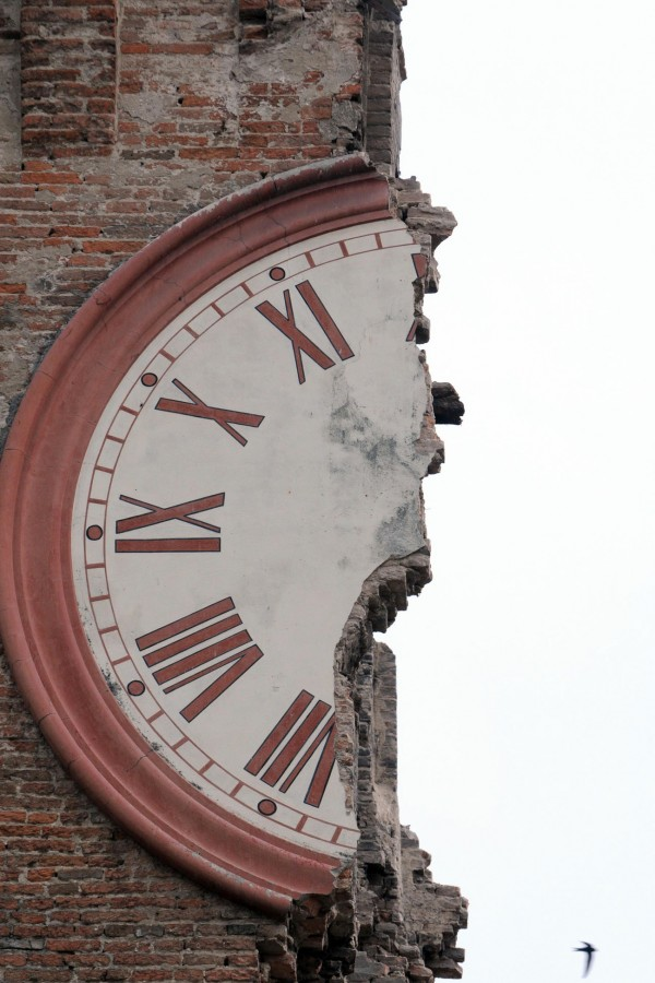 The damaged clock tower of Finale Emilia, Italy on Sunday, May 20, 2012. A magnitude 6 earthquake shook northern Italy early Sunday, killing at least four people. The quake struck at 4:04 a.m. Sunday between Modena and Mantova, about 22 miles north of Bologna at a relatively shallow depth of 6 miles, the U.S. Geological Survey said.