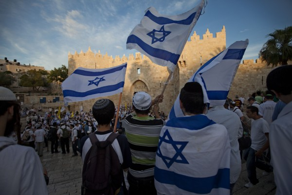 Israeli youths wave Israeli flags during a march celebrating Jerusalem Day in front of Damascus Gate in Jerusalem's Old City on Sunday, May 20, 2012. Jerusalem Day marks Israel's capture of east Jerusalem and the reunification of the city, which had been divided into Israeli and Jordanian sectors from Israel's establishment in 1948 until the 1967 war.