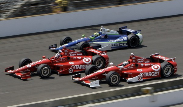 Dario Franchitti, center, of Scotland, leads teammate Scott Dixon, bottom, of New Zealand, and Tony Kanaan, top, of Brazil, to the finish line on the final lap of IndyCar's Indianapolis 500 auto race at Indianapolis Motor Speedway in Indianapolis, Sunday, May 27, 2012.