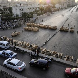 Egypt's interim government offers to step down as protests rage