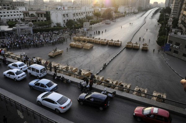 Armored Egyptian military vehicles block the road outside of the Ministry of Defense in Cairo, Egypt, Friday, May 4, 2012.
