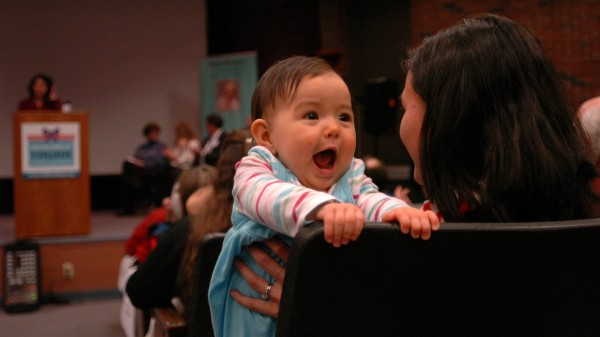 Nine-month-old Sophia Dunham of Farmingdale makes faces over mother Kim''s shoulder during the Harold Alfond College Challenge press conference and Baby Portrait Event for the Future Faces of Maine held in December 2008 at the University of Maine at Augusta. The event celebrated the nation''s first statewide philanthropic college savings grant program, which allows all Maine resident babies born in 2009 to be eligible for $500 to be used for higher education.