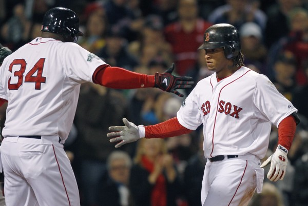 Boston Red Sox left fielder Darnell McDonald, right, celebrates with designated hitter David Ortiz at home plate after his two-run, home run in the third inning of a baseball game against the Oakland Athletics at Fenway Park in Boston, Monday, April 30, 2012.  McDonald drove in Ortiz on the homer.