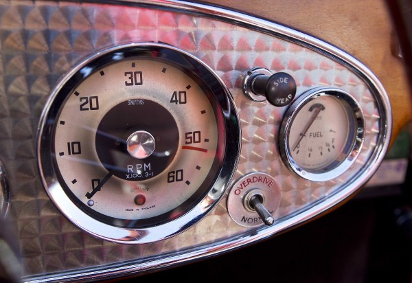 The speedometer, gas gauge and overdrive switch on the the stainless steel instrument panel of Jim Begin's restored 1962 Austin Healey roadster.