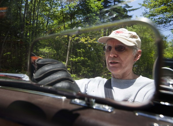 Jim Begin, of Richmond wears driving gloves while driving through  Brunswick, Saturday, May 19.