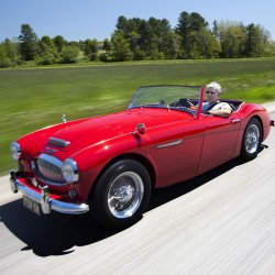 Jim Begin of Richmond drives his 1962 Austin Healey 3000 Tri-Carb Roadster down a Highland Road in Brunswick, Saturday, May 19. Healey paid $250 for the car in 1978.