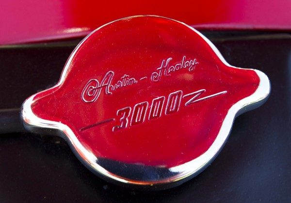 A stainless steel radiator cap reflects the paint job on Jim Begin's 1962 Austin Healey.