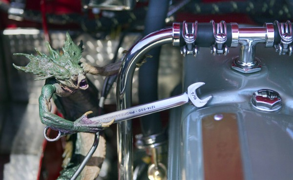 A gremlin wielding a wrench often starts conversations when the curious peer under the hood of Jim Begin's Austin Healey at car shows. He makes sure he removes it before driving away.