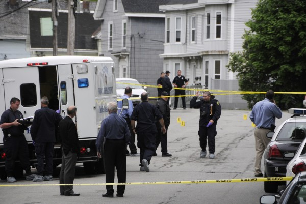 Bangor Police investigate the area of a fatal stabbing on First Street in Bangor on Tuesday.