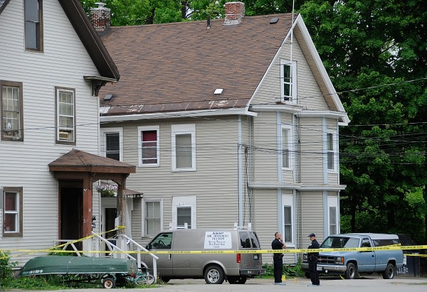 Bangor Police investigate the area of a fatal stabbing on First Street in Bangor that took place there early Tuesday, May 22, 2012.