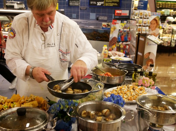 Chef Kevin Fallen of Personal Touch Catering whips up a few tasty dishes from the sea at the Hannaford supermarket in Scarborough on Wednesday, May 23, 2012 as the chain announces its intention to offer only sustainably harvested and grown seafood.