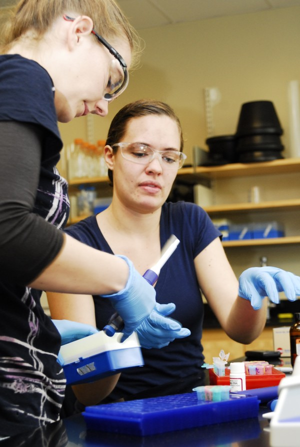 Robin Spielmann (left), a second-year pharmacy student from Indiana, and Krystal Lacombe (right), a fourth-year pharmacy student from Winslow, Maine, extract RNA as part of their research at the University of New England's Genomics, Analytics and Proteomics core facility in Portland on May 15, 2012. The equipment the students use has been purchased with funds from the college and from past research and development bonds approved by Maine voters.
