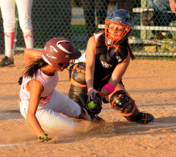 Brewer High School's catcher Sarah Babin (right) tags  Bangor High School's Jade Baumrind at home plate during the game in Brewer Monday evening.
