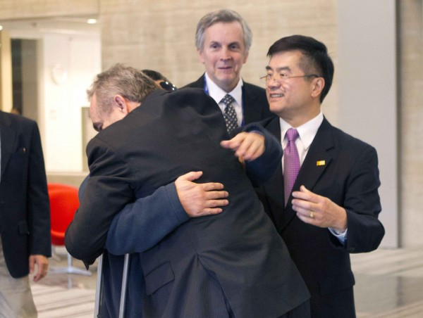Blind lawyer Chen Guangcheng (obscured) is embraced by U.S. Assistant Secretary of State for East Asia and Pacific Affairs Kurt Campbell as U.S. Ambassador to China Gary Locke (right) looks on before leaving the U.S. Embassy for a hospital in Beijing on Wednesday May 2, 2012.