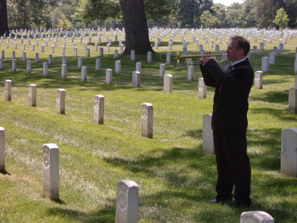 Ron Clark of Belfast participates in the Bugles Across America event in Arlington National Cemetery on Saturday, May 19, 2012.