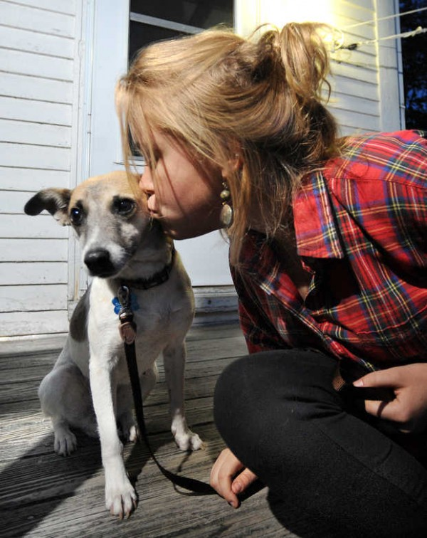 Sierra Guay kisses her dog Nallel on the front steps of her home in Lisbon Falls. Guay rescued the dog from Mexico.