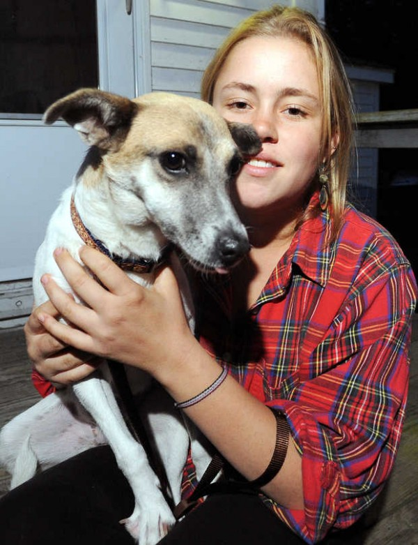 Sierra Guay and her dog Nallel relax at her home in Lisbon Falls. Guay rescued the dog from Mexico.