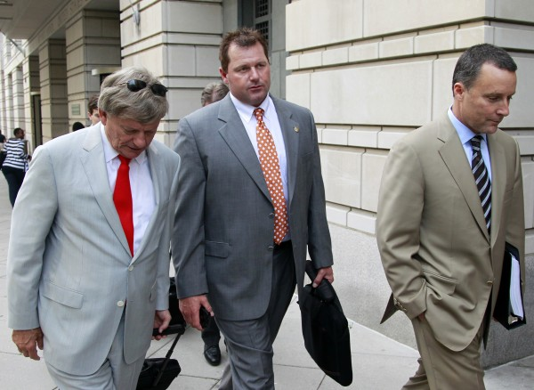 Former Major League Baseball pitcher Roger Clemens (center) and his lawyers Rusty Hardin (left) and Michael Attanasio leave a federal courthouse Wednesday, May 2, 2012, in Washington as his retrial continues on charges of lying to Congress in 2008 when he said he had never used steroids of human growth hormone.