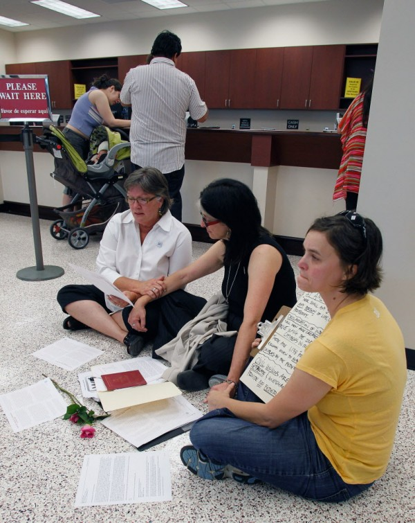 Mary Lea Bradford of Winston-Salem, left, Mary Jamis of Mocksville, center and Christine Regan of Winston-Salem stage a sit-in after being refused marriage licenses at the Forsyth County Register of Deeds office in Winston-Salem, N.C., Thursday, May 10, 2012.