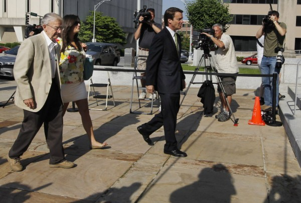 Former Sen. John  Edwards, right, leads his father Wallace Edwards and daughter Cate Edwards into the Federal Courthouse in Greensboro, N.C. Wednesday, May 2, 2012.  Edwards is accused of conspiring to secretly obtain more than $900,000 from two wealthy supporters to hide his extramarital affair with Rielle Hunter and her pregnancy from the media. He has pleaded not guilty to six charges related to violations of campaign-finance laws.