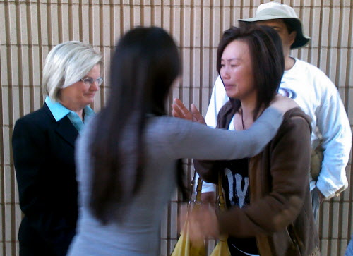 Bei Bei Shuai, 35, second left, of Indianapolis, hugs her friend, Sue Mak, right, as attorney Linda Pence, left, looks on after Shuai's release on bail from the Marion County Jail in Indianapolis on Tuesday, May 22, 2012. Shuai faces a December trial on charges of murder and feticide. Shuai, a Shanghai native, ate rat poison in a suicide attempt in December 2010 when she was 33 weeks pregnant.