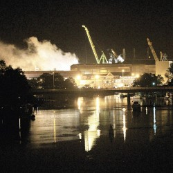 Smoke rises from a dry dock as fire crews respond May 23, 2012 to a fire on the USS Miami SSN 755 submarine at the Portsmouth Naval Shipyard in Kittery, Maine.