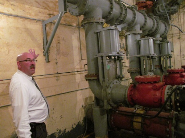 Eric Labelle, deputy director of Portland Public Services, gestures toward the pumping equipment nearly 30 feet below street level at Franklin Street Pump Station Thursday, May 31, 2012, during a city tour of sites relevant to a planned overhaul of the sewer system.