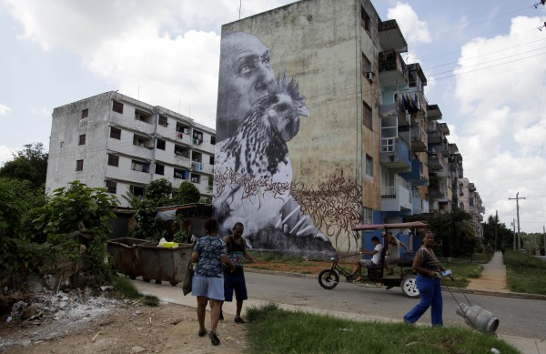 People walk in front of an installation by Cuban-American artist Jose Parla titled &quotWrinkles of The City&quot as part of the 11th Havana Biennial contemporary art exhibition in Havana, Cuba, Thursday, May 10, 2012.
