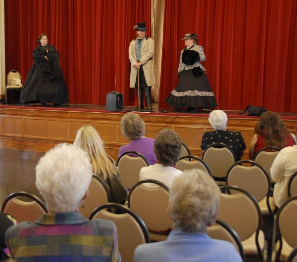 Todd and Becky Olson of Phillips played the roles of a Florida subtler and his wife during the Civil War Fashion Show held May 12 in the Prescott Building at Good Will Hinckley School in Fairfield. Emceeing the fashion show from on stage was Miss Christabell Rose (left), a Civil War re-enactor.