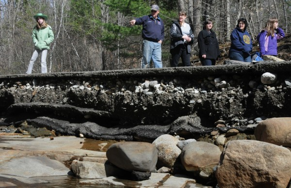 The Pattersons, Watkins and Harveys take a Saturday afternoon family stroll along the newly eroded the Swetts Pond Road created by the dam breach in Orrington on Friday, March 23, 2012.