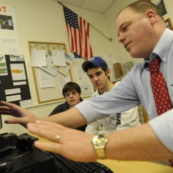 Deer Isle-Stonington High School Principal Todd West visits a technology class in 2010. West is credited with leading the implementation of changes that have significantly improved the small school's graduation rate and reduced the number of dropouts.